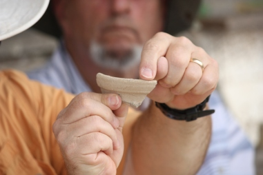 Pottery reading on the roof of the Galilee Hotel, 2015. Holding the sherd: James Riley Strange; in the background: Denny Groh. Photo by Penny Long Marler.