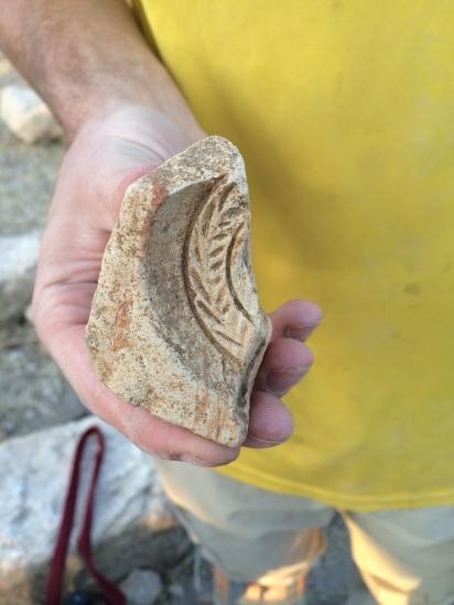 Matt Hughes holding a fragment of a lamp mold